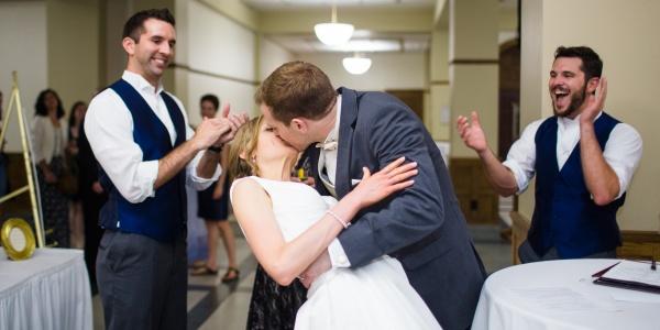 Happy couple kissing at wedding