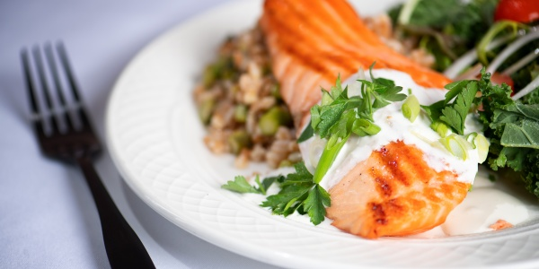 Salmon with lettuce greens