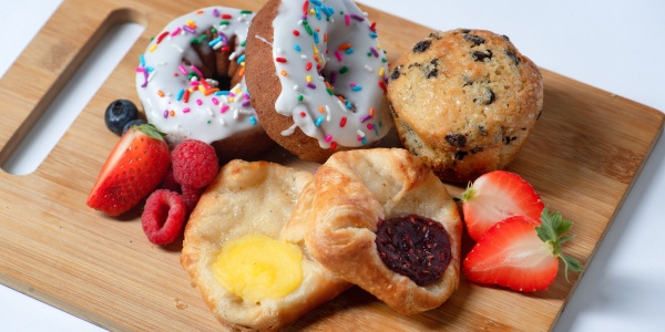Donuts, pastries, and fresh fruit