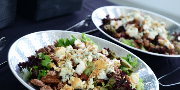 Three fresh salads with mixed greens