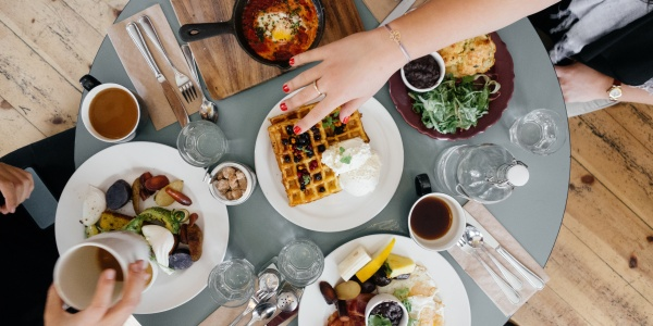 Individuals eating breakfast