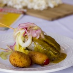 Pickle with onion on fried cheese bite