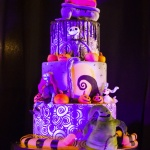 Four layer cake decorated with skeletons and pumpkins